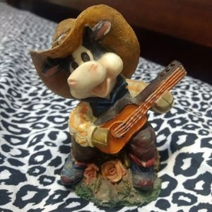 Small vintage cowboy figurine with guitar or banjo